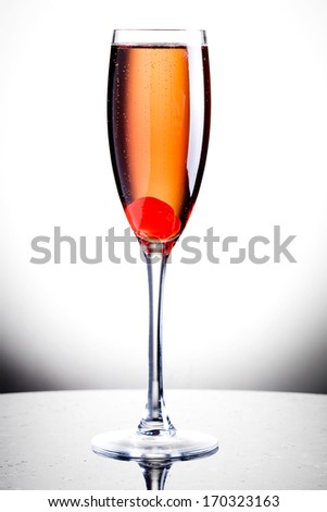 Champagne Cocktail with liquor and cherry