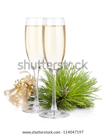 Champagne glasses and christmas bells. Isolated on white backgound