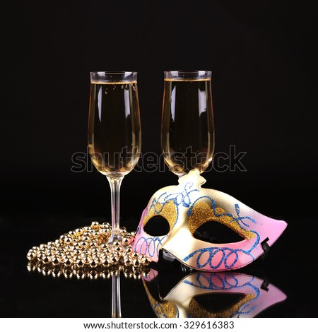 Champagne.New Year's Eve.Celebration. Female carnival mask with glass of champagne