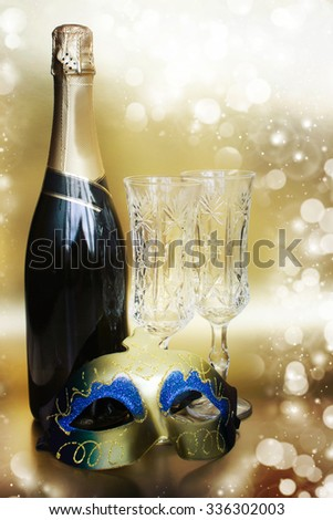Champagne.New Year with mask