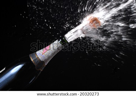 champagne splashing for new year eve celebration