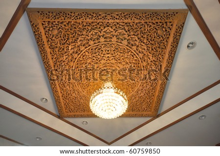 Chandelier with wooden carving