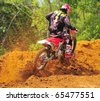 CHANTABURI, THAILAND - FEB 7: Thailand motocross championship 2010 first round on February 7, 2010 in Chantaburi, Thailand, Unknown rider - stock photo
