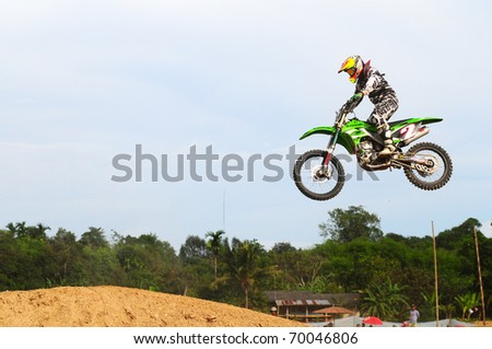 CHANTABURI, THAILAND - FEB 7: Unidentified rider in action at Thailand motocross championship 2010 first round on February 7, 2010 in Chantaburi, Thailand,