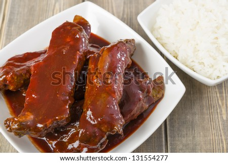Char Siu - Chinese sticky pork spare ribs roasted with a sweet and savoury sauce served with boiled rice.