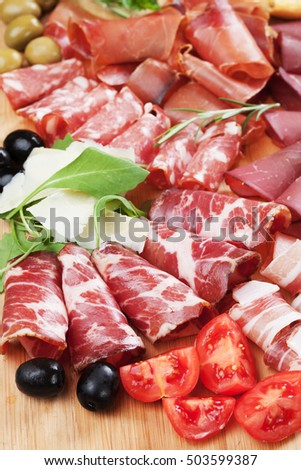 Charcuterie board with italian style cured meat, capocollo, pancetta,bresaola,salami and prosciutto