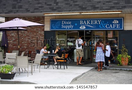 CHARLESTON - JUL 22: Customers entering and eating at the Dixie Supply Bakery & Cafe in Charleston, SC. Featured on Diners, Drive-Ins and Dives on the Food Network channel July 30, 2012.