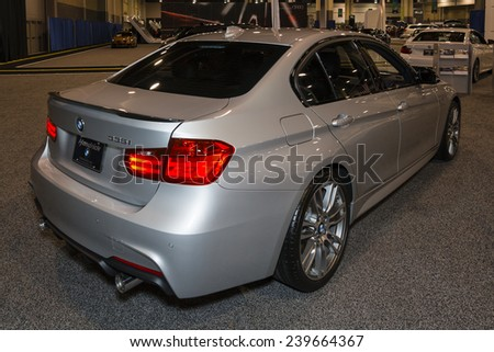 CHARLOTTE, NORTH CAROLINA - NOVEMBER 20, 2014: BMW 335i sedan on display during the 2014 Charlotte International Auto Show at the Charlotte Convention Center.