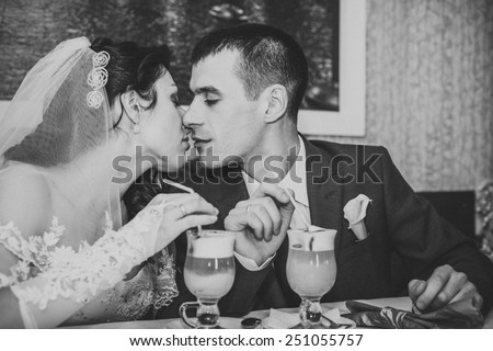 Charming bride and groom on their wedding celebration in a expensive interior luxury restaurant.
