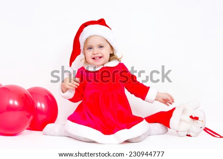 Charming girl happy Christmas gifts on white background