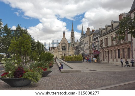 CHARTRES, FRANCE   JULY 29, 2015:  View of old church and buildings in the center of the city with famous cathedral spires on the background