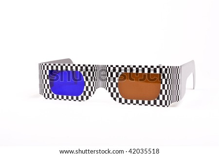 Cheap cardboard 3D spectacles with blue and amber lenses isolated against white background.