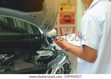 Check the details of the vehicle in order to repair.Detail of lifted automobile at repair service station