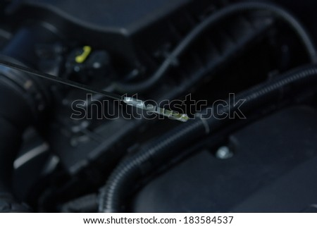 Checking oil level in a car engine