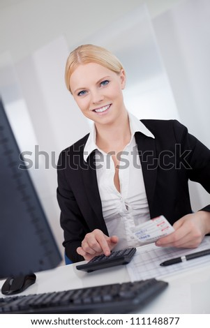 Cheerful accountant businesswoman working in the office