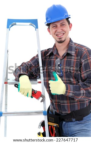 Cheerful carpenter showing thumbs up on the white background. Isolated on white