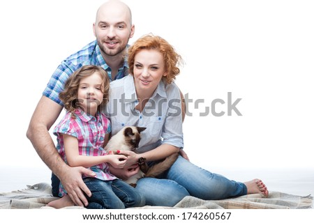 cheerful caucasian smiling happy family hugging isolated on white