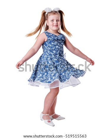 Cheerful girl spinning on floor isolated on white