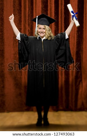 Cheerful graduated girl with mortarboard and diploma