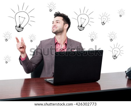Cheerful handsome businessman solving a problem and looking happy in his office with drawn lightbulbs