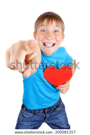 Cheerful Kid with Red Heart Shape pointing at You on the White Background