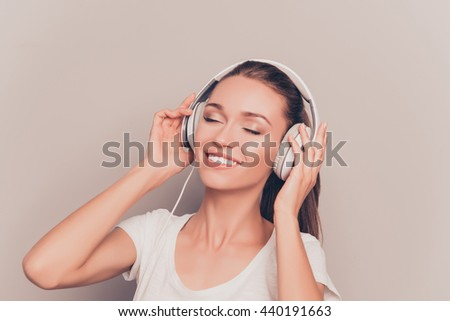 Cheerful relaxed music lover listening music in headphones