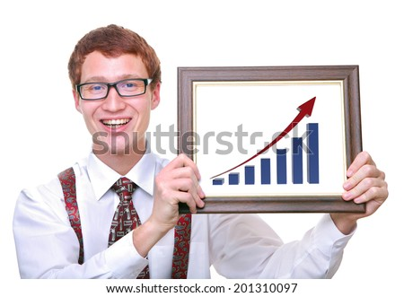 cheerful successful  businessman holding a chart showing his profits