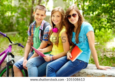 Cheerful teens spending time together after school