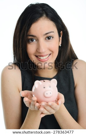 cheerful young brunette woman holding a piggy bank in her hands