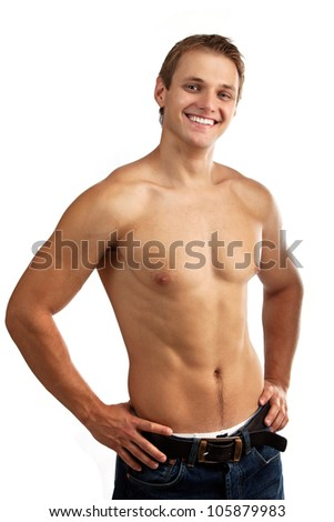 Cheerful young man in jeans with bare torso