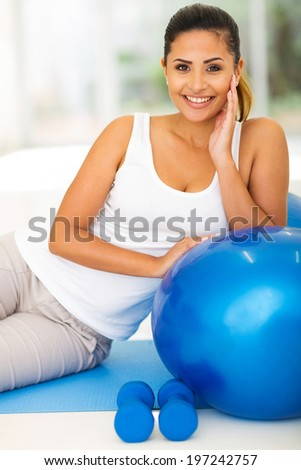 cheerful young woman resting after the exercise