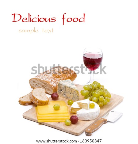 Cheese platter, grapes, ciabatta and a glass of red wine, isolated on white