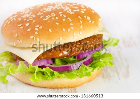 cheeseburger on white table