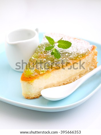 cheesecake with kiwi on a plate decorated with mint