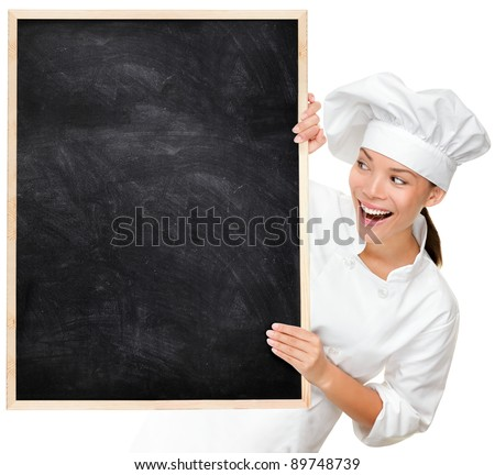 Chef showing blank menu sign blackboard. Woman Cook or baker looking happy and excited wearing chef uniform. Multicultural Asian Caucasian young female chef isolated on white background.