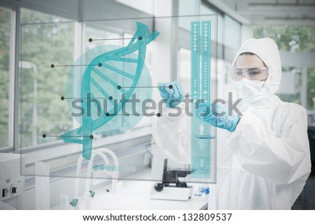 Chemist working cautiously with blue liquid and futuristic interface with dna diagram on it