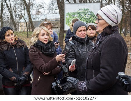 CHERNIHIV, UKRAINE - 24 November 2016: Female journalists with recorders interviewing local ethnographer