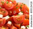 Cherry tomato wedges with cheese and chives prepared as salad (Selective Focus, Focus one third into the picture) - stock photo