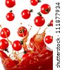 Cherry tomatoes splash in tomato sauce - stock photo