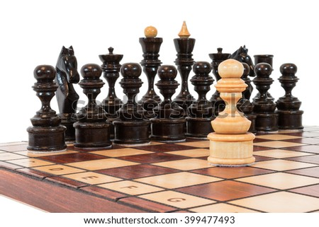 Chess game figures on the board isolated on white