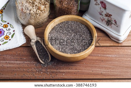 Chia seeds over wooden background