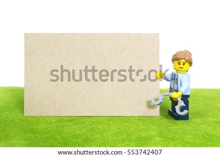 Chiang Mai , Thailand - Jan 11 : Studio shot of Lego, police holding empty brown paper on January 11 , 2017 in Chiang Mai, Thailand