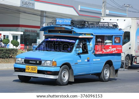 CHIANGMAI, THAILAND -JANUARY 21 2016:   Blue Pickup  truck taxi Lamphun, Service between Lamphun city and Around. Photo at road no.121 about 8 km from downtown Chiangmai, thailand.