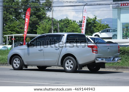 CHIANGMAI, THAILAND -JULY 27 2016:  Private car, Mitsubishi Triton Pickup Truck.  On road no.1001, 8 km from Chiangmai Business Area.