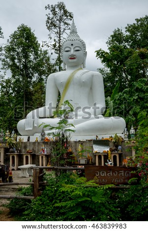 ChiangMai, Thailand. June, 08-2016: The Buddha image situated in front of cloudy sky.