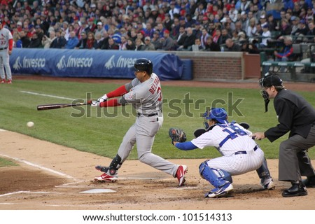 CHICAGO - APRIL 25: Skip Schumaker of the St. Louis Cardinals hits a ball during a game against the Chicago Cubs at Wrigley Field on April 25, 2012 in Chicago, Illinois.