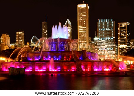 CHICAGO - 2010:  Buckingham Fountain illuminated at night against the backdrop of downtown skyscrapers, as seen in Chicago circa 2010.