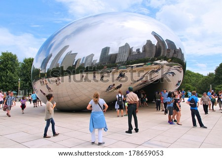 CHICAGO, USA - JUNE 26, 2013: People visit Cloud Gate in Millennium Park in Chicago. With 2.7 million residents, Chicago is the 3rd most populous city in the USA.
