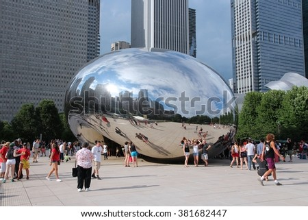 CHICAGO, USA - JUNE 28, 2013: People visit the Bean (Cloud Gate) in Millennium Park in Chicago. With 2.7 million residents, Chicago is the 3rd most populous city in the USA.