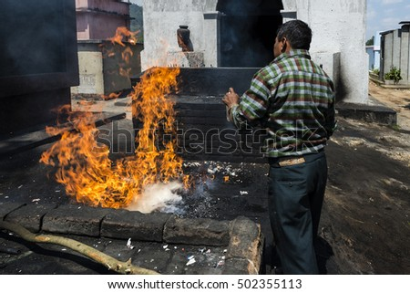 Chichicastenango, Guatemala - April 26, 2014: Maya man performing a ritual in the cemetery of the town of Chichicastenango, in Guatemala